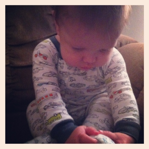 Favorite Picture of Jack - It's sooo hard to pick one (or two), but I love him discovering his footie pj's.