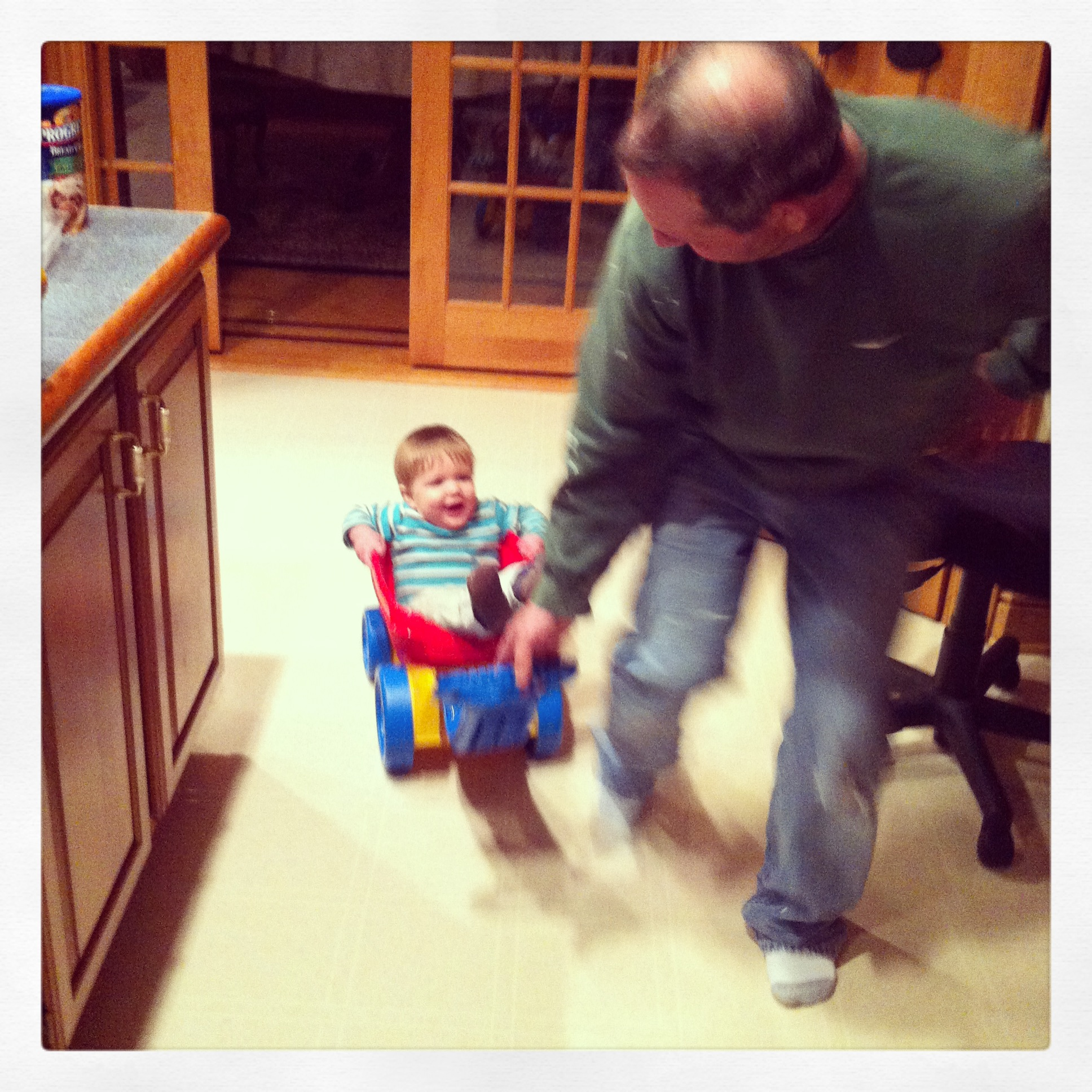 Favorite Grandpa Picture - running around the kitchen laughing at each other.